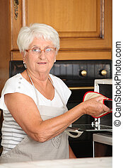 Elderly woman in home kitchen