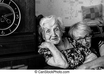 Elderly woman in home with his adult daughter.