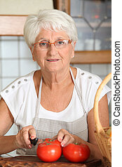 Elderly woman in kitchen