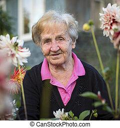 elderly woman in the garden.
