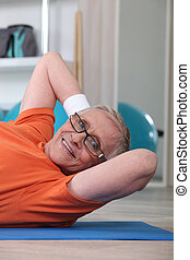Elderly woman in the gym