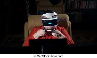 Elderly woman in VR headset playing virtual reality game in front of TV screen