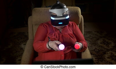 Elderly woman in VR headset uses move motion controller for video game console