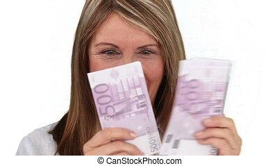 Elderly woman is in love of her money