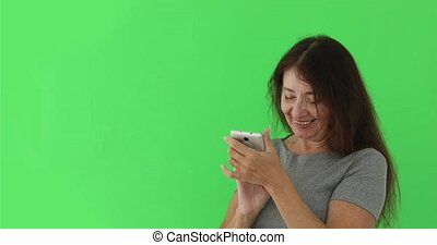 Elderly woman looks at photos on a smartphone
