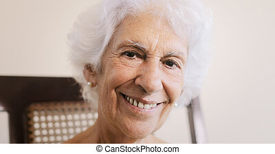 Elderly Woman Old Lady Relaxing On Rocking Chair At Home