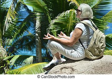 Elderly woman  on beach