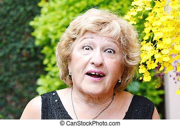 Elderly woman outdoors.