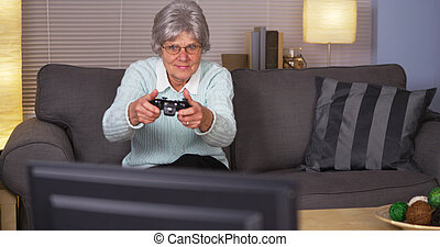 Elderly woman playing videogames