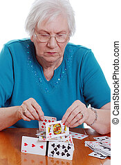 elderly woman playing with cards