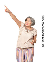 Elderly woman pointing - Senior lady pointing with finger on...