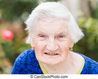 Elderly woman - Portrait of elderly woman smiling at the ...