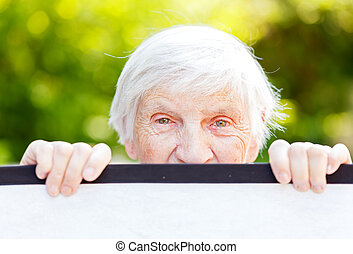 Elderly woman - Portrait of the smiling elderly woman on ...