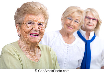 Elderly woman portrait with girlfriends.