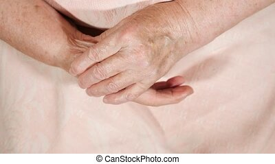 elderly woman probes her fingers. Hands close-up