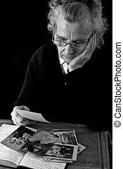 old photographs - elderly woman reading old letters and ...
