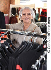 Elderly woman shopping