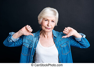 Elderly woman showing disapproval