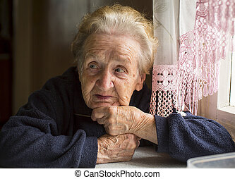 Elderly woman sitting at table
