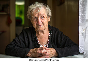 elderly woman sitting at the table