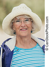 Elderly Woman Smiling at the Beach