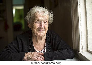 Elderly woman smiling sitting