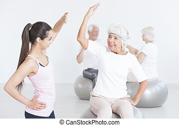 Elderly woman stretching properly