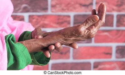 Elderly woman suffering from pain