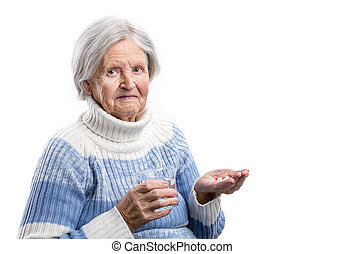 Elderly woman taking her medication