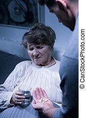 Elderly woman taking medicines