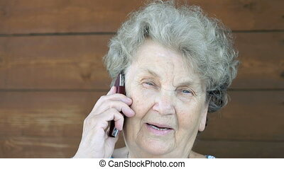 Elderly woman talking on the mobile phone