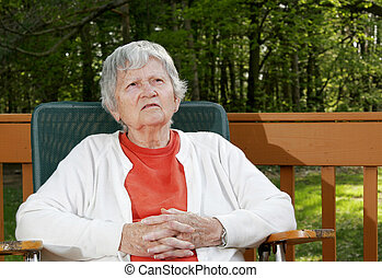 elderly woman thinking