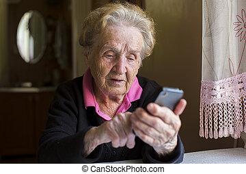 Elderly woman typing