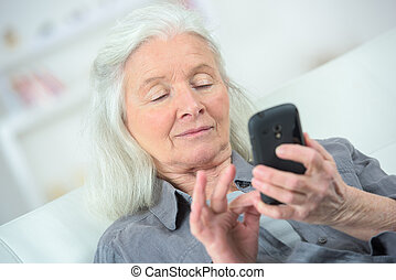 Elderly woman using a smartphone