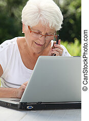 Elderly woman using internet
