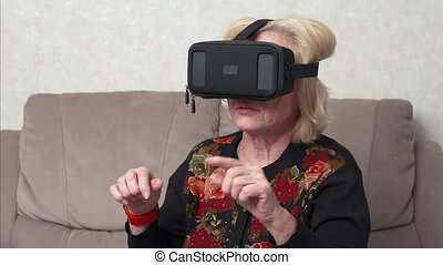 Senior woman using vr headset