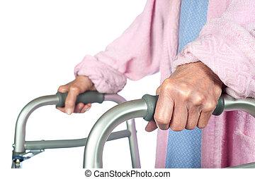 Elderly woman using walker
