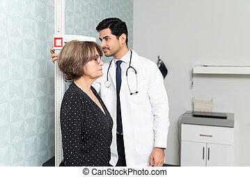 Elderly Woman Visiting Doctor For Regular Checkup