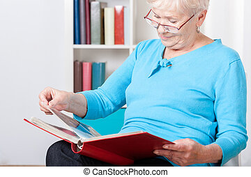 Elderly woman watching photos