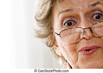 Elderly woman wearing reading glasses - Close-up of elderly ...
