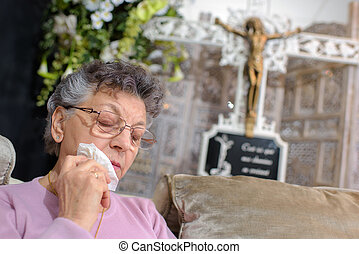 elderly woman weeping