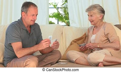 Elderly woman winning against her husband