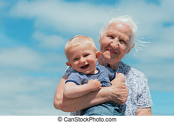 Elderly woman with a baby