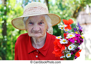 Elderly woman with a bouquet