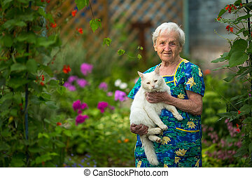 Elderly woman with a cat