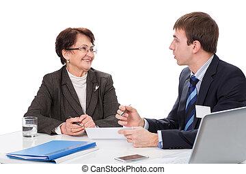 Elderly woman with a financial advisor
