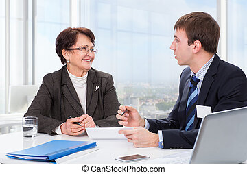 Elderly woman with a financial advisor