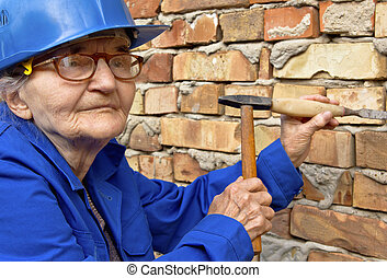 Elderly woman with a hammer and chisel.