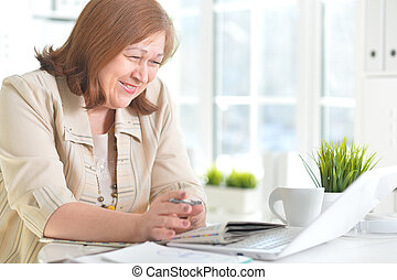 Elderly woman with a laptop