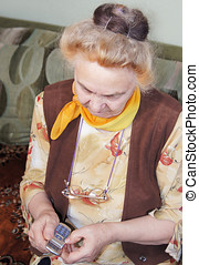 Elderly woman with a mobile phone